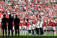 Arsenal players observe a minute's silence to remember the victims of the Grenfell Tower fire during Arsenal vs Chelsea, FA Community Shield Football at Wembley Stadium on 6th August 2017
