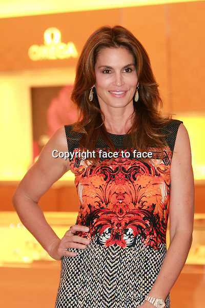 MIAMI, FL - DECEMBER 4: Cindy Crawford at the grand opening of OMEGA Boutique at Aventura Mall in Miami, Florida on December 4, 2013. <br />