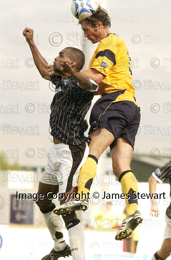05/08/2006        Copyright Pic: James Stewart.File Name : sct_jspa14_falkirk_v_dunfermline.KENNY MILNE HEADS CLEARS FROM FREDDIE DAQUIN......Payments to :.James Stewart Photo Agency 19 Carronlea Drive, Falkirk. FK2 8DN      Vat Reg No. 607 6932 25.Office     : +44 (0)1324 570906     .Mobile   : +44 (0)7721 416997.Fax         : +44 (0)1324 570906.E-mail  :  jim@jspa.co.uk.If you require further information then contact Jim Stewart on any of the numbers above.........