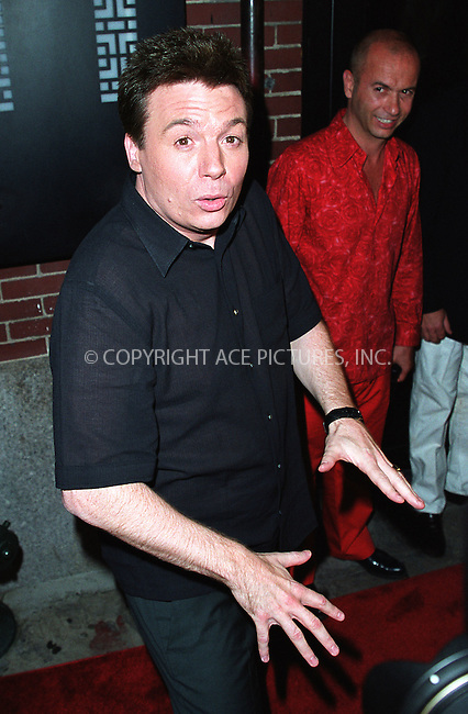 Actor Mike Myers striking a pose at the party celebration of the first anniversary of his club Man Ray. Restauranter and co-owner of Man Ray, Thierry Klemenuiek, chuckling in the background. New York, July 10, 2002. Please byline: Alecsey Boldeskul/NY Photo Press.   ..*PAY-PER-USE*      ....NY Photo Press:  ..phone (646) 267-6913;   ..e-mail: info@nyphotopress.com