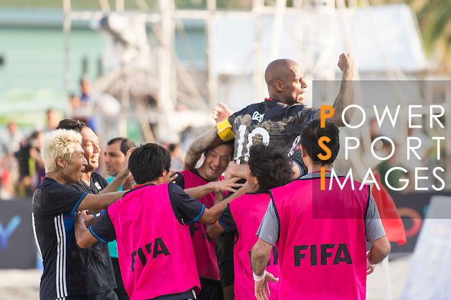 MOREIRA Ozu of Japan celebrates with teammates during the Beach Soccer Men's Team Gold Medal Match between Japan vs Oman on Day Nine of the 5th Asian Beach Games 2016 at Bien Dong Park on 02 October 2016, in Danang, Vietnam. Photo by Marcio Machado / Power Sport Images