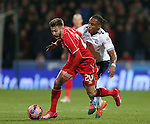 Adam Lallana of Liverpool and Neill Danns of Bolton Wanderers - FA Cup Fourth Round replay - Bolton Wanderers vs Liverpool - Macron Stadium  - Bolton - England - 4th February 2015 - Picture Simon Bellis/Sportimage
