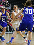 SIOUX FALLS, SD - February 13: Ellie Brecht #34 from Sioux Falls Lincoln drives between Marissa Hirchert #52 and Alexis Marsico #30 from Rapid City Stevens in the first half of their game Friday night at the Denny Sanford Premier Center. (Photo by Dave Eggen/Inertia)