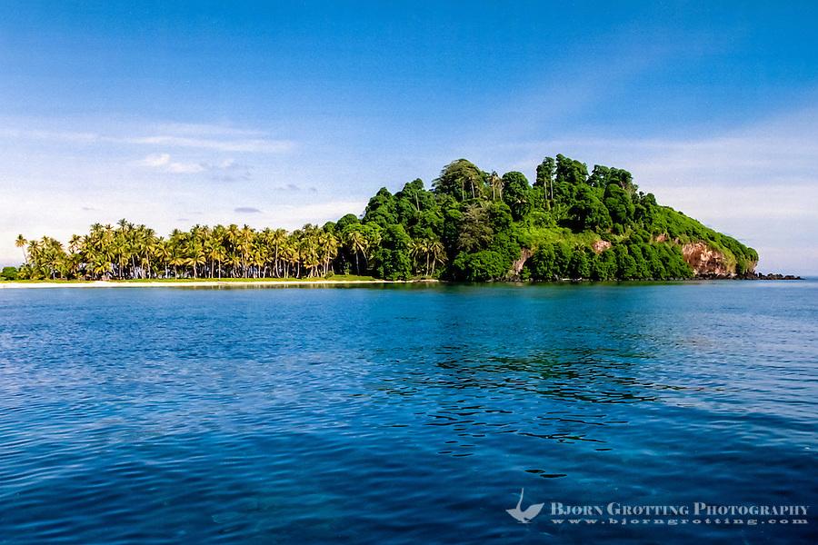 Riau Islands, Natuna Islands. Southwest Natuna. Small island just north of Kalimantan. Beach and palm trees.