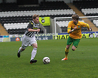 Barry Cuddihy being tracked by Filip Twardzik in the St Mirren v Celtic Scottish Professional Football League Under 20 match played at St Mirren Park, Paisley on 30.4.14.