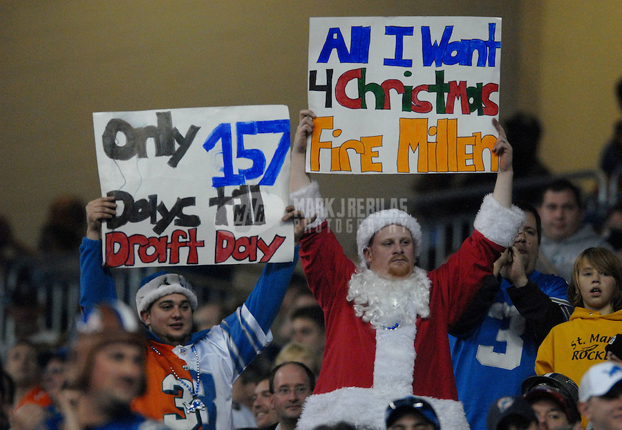 Nov. 23, 2006; Detroit, MI, USA; Detroit Lions fans in the stands hold signs during the game against the Miami Dolphins at Ford Field in Detroit, Michigan. The Dolphins defeated the Lions 27-10. Mandatory Credit: Mark J. Rebilas