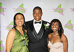 """Friend and Master of Ceremony Sharif Atkins (White  Coller """"Agent Jones"""", ER """"Michael Gallant"""", The Good Wife and more) gets a boutineer from Delaina Dixon - President - Alpha Kappa Alpha Sorority, Incorporated Pi Psi Omega Chapter welcomes you to """"A Pink Carpet Affair"""" - celebrating 25 years of Sisterhood and Service on June 9, 2012 at the Comfort Inn and Suites, Nanuet, New York. (Photo by Sue Coflin/Max Photos)"""