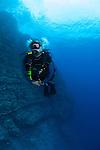Diver on a drift dive at the backwall Molokini Maui Hawaii