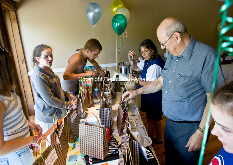 WOLCOTT, CT - 11 JULY 2010 -071110JT01-<br /> Clockwise from left, Victoria Becker, Sara Wrenn and Brad Becker sell raffle tickets to Judie Ostroski of Bristol and Robert Duguay fo Waterbury during a fundraiser dinner and raffle for the children of Cindy Dunn Cannon, who police say was murdered by her husband in May.<br /> Josalee Thrift Republican-American