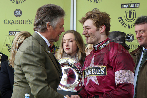 09.04.2016. Aintree, Liverpool, England. Crabbies Grand National Rac during  Festival Day 3. Winning jockey David Mullins is congratulated at the prize presentation.