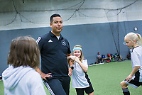 "NWA Democrat-Gazette/CHARLIE KAIJO Addison Rash, 9, (center right) goofs off with Coach Nadir Franco (center left), Monday, November 25, 2019 during a two-day soccer skills camp at The Strike Zone Training Academy in Rogers.<br /> <br /> Coaches led their second annual Thanksgiving, skills camp to teach kids soccer skills like first touch (how to receive the ball) and finishing (taking a quick, powerful shot). ""It's not something focused on enough in youth soccer,"" said Courtney Heinlich, owner of Strike Zone Training Academy."