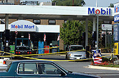 Aspen Hill, MD - October 3, 2002 -- The scene at the  Aspen Hill Mobil where 54-year-old part-time taxi driver Premkumar Walekar was shot and killed this morning, 3 October, 2002 in Aspen Hill, MD.  The cab is at left and the van with the blood stains is at right.<br /> Credit: Ron Sachs / CNP<br /> <br /> (RESTRICTION: NO New York or New Jersey Newspapers or newspapers within a 75 mile radius of New York City)