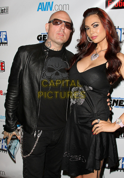EVAN SEINFELD & TERA PATRICK .2008 FAME Awards aka Fans of Adult Media Entertainment held at the  Los Angeles Convention Center, Los Angeles, California, USA..June 7th, 2008.half length black dress tattoos leather jacket sunglasses shades award trophy.CAP/ADM/CH.©Charles Harris/AdMedia/Capital Pictures