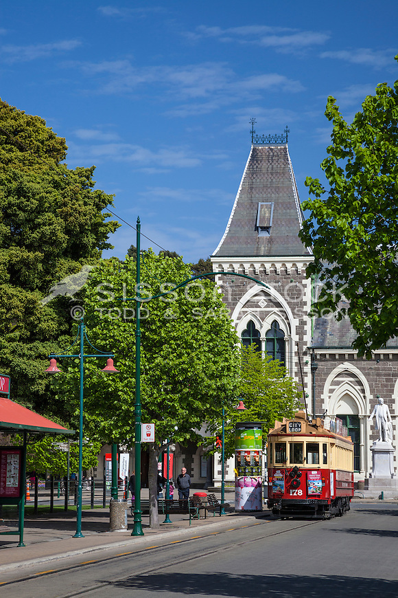 New Zealand Photos | Christchurch tram passes the Canterbury Museum, Canterbury, New Zealand (pre 2011 earthquake) - stock photo, canvas, fine art print