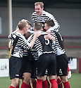 Shire's Michael McGowan is mobbed by team mates after he scores their goal.