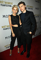 5 January 2018 - Los Angeles, California - Caroline Daur and Nolan Gerard Funk. Moet &amp; Chandon Celebrates the 3rd Annual Moet Moment Film Festival Golden Globes Week held at Poppy in Los Angeles. <br /> CAP/ADM<br /> &copy;ADM/Capital Pictures