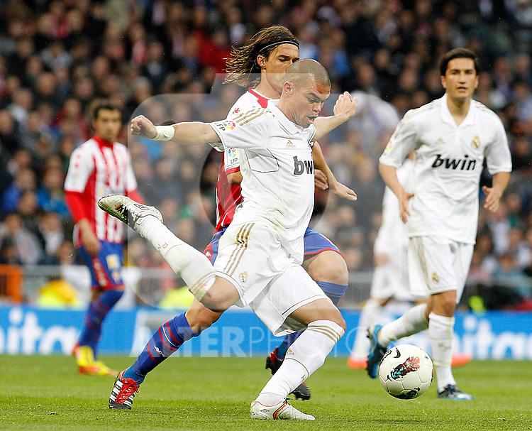 Real Madrid's Pepe (f) and Sporting de Gijon's Gaston Maximiliano Sangoy during La Liga match.April 14,2012. (ALTERPHOTOS/Acero)