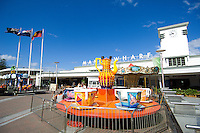 A tea-cup ride in front of Manly Wharf, Sydney, Australia.