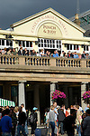People on terrace of Punch and Judy pub in Covent Garden, London, England