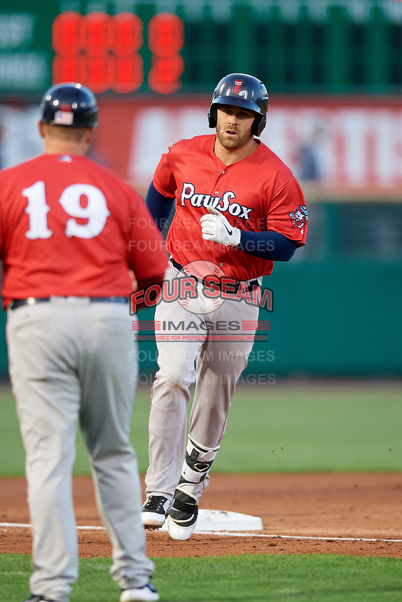 Pawtucket Red Sox third baseman Mike Olt (5) is congratulated by manager Kevin Boles (19) as he rounds third base after hitting a home in the top of the fifth inning during a game against the Rochester Red Wings on May 19, 2018 at Frontier Field in Rochester, New York.  Rochester defeated Pawtucket 2-1.  (Mike Janes/Four Seam Images)