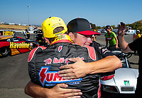 Jul 28, 2019; Sonoma, CA, USA; NHRA pro stock driver Greg Anderson celebrates with son Cody Anderson after winning the Sonoma Nationals at Sonoma Raceway. Mandatory Credit: Mark J. Rebilas-USA TODAY Sports