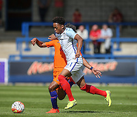 Chris Willock (Arsenal) of England U19 holds off Mitchell Van Rooijen (Jong FC Utrecht) of Holland during the International match between England U19 and Netherlands U19 at New Bucks Head, Telford, England on 1 September 2016. Photo by Andy Rowland.