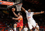 Spain's guard Sergio Llull vies with France's forward Florent Pietrus during the 2014 FIBA World basketball championships quarters of final match Spain vs France at the Palacio de los Deportes in Madrid on September 10, 2014.  PHOTOCALL3000 / DP
