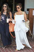 Greek goddess look: Pregnant Kourtney Kardashian wore an all white flowing dress and beige Balenciaga bag while shopping at Fred Segal in West Hollywood. Los Angeles, California on 16.05.2012.Credit: Vida/face to face /MediaPunch Inc. ***FOR USA ONLY***