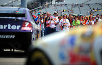 May 2, 2008; Richmond, VA, USA; Fans look on as NASCAR Sprint Cup Series drivers head out of the garage during practice for the Dan Lowry 400 at the Richmond International Raceway. Mandatory Credit: Mark J. Rebilas-US PRESSWIRE