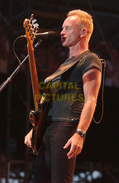 """STING of """"The Police"""".2nd Annual Virgin Festival By Virgin Mobile - Day One held at Pimilco Race Course, Baltimore, Maryland, USA,.04 August 2007..live in concert on stage gig guitar funny.CAP/ADM/DS.©Devin Simmons/AdMedia/Capital Pictures."""