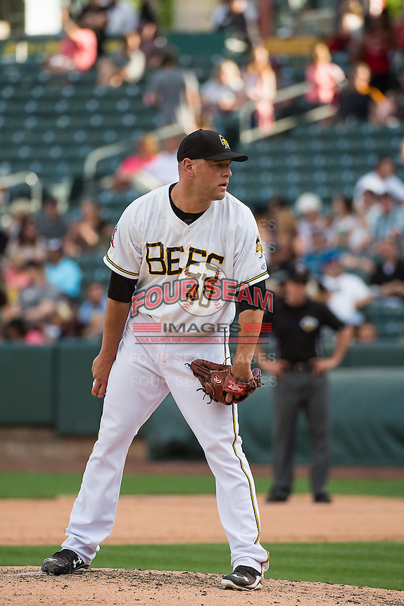 Frank Herrmann (40) of the Salt Lake Bees looks to his catcher for the sign against the Albuquerque Isotopes in Pacific Coast League action at Smith's Ballpark on June 8, 2015 in Salt Lake City, Utah.  The Bees defeated the Isotopes 10-7 in game one of a double-header.(Stephen Smith/Four Seam Images)