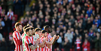 Lincoln City players during a minutes applause in memory of Gordon Banks<br /> <br /> Photographer Chris Vaughan/CameraSport<br /> <br /> The EFL Sky Bet League Two - Lincoln City v Stevenage - Saturday 16th February 2019 - Sincil Bank - Lincoln<br /> <br /> World Copyright © 2019 CameraSport. All rights reserved. 43 Linden Ave. Countesthorpe. Leicester. England. LE8 5PG - Tel: +44 (0) 116 277 4147 - admin@camerasport.com - www.camerasport.com