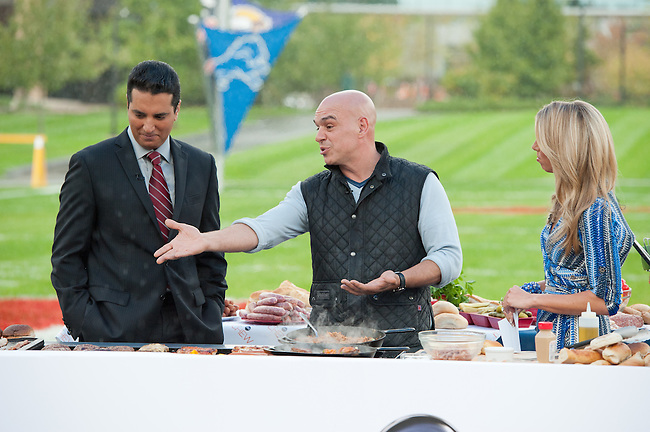 "October  14, 2011 - Bristol, CT - Campus Green: ABC's ""The Chew"" Chef Michael Symon with SportsCenter anchors Sara Walsh and Kevin Negandhi..Credit: Joe Faraoni"