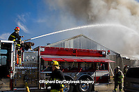 63818-02203 Firefighters extinguishing warehouse fire, Salem, IL