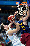 Real Madrid's player Luka Doncic and Barcelona's player Satoransky during Liga Endesa 2015/2016 Finals 3rd leg match at Barclaycard Center in Madrid. June 20, 2016. (ALTERPHOTOS/BorjaB.Hojas)