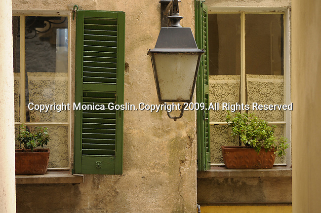 Two windows with green shudders in Brienno, a town on Lake Como, Italy.
