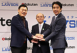 October 6, 2017, Tokyo, Japan - (L-R) Japan's online commerce giant Rakuten president Hiroshi Mikitani shakes hands with Fukushima's Minamisoma city mayor Katsunobu Sakurai and convenience store chain Lawson president Sadanobu Takemasu smile as they announced Rakuten and Lawson will start a trial service to deliver Lawson's goods with Rakuten's drone in Minamisoma city end of this month in Tokyo on Friday, October 6 2017. Minamisoma's Odaka district was designated as a district under evacuation orders  due to the nuclear accident of TEPCO's Fukushima Dai-ichi nuclear plant caused by tsunami and Lawson opened the first convenience store in the area last year.    (Photo by Yoshio Tsunoda/AFLO) LWX -ytd-