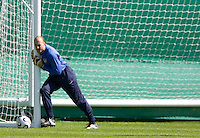 Kasey Keller stretches before training in Hamburg, Germany, for the 2006 World Cup, June, 8, 2006.