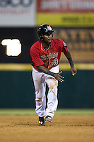 Juremi Profar (23) of the Hickory Crawdads takes his lead off of second base against the Charleston RiverDogs at L.P. Frans Stadium on August 25, 2015 in Hickory, North Carolina.  The Crawdads defeated the RiverDogs 7-4.  (Brian Westerholt/Four Seam Images)