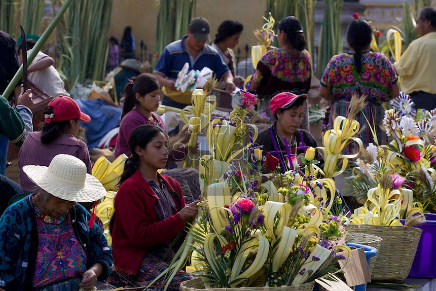 People make palm branches in front of La Iglesia La Merced. Easter week in Guatemala features lavish, devoted celebrations and throngs of tourists travel to Antigua for the occasion.