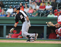 Catcher Jorge Alfaro (11) of the Hickory Crawdads in a game against the Greenville Drive on April 9, 2012, at Fluor Field at the West End in Greenville, South Carolina. Alfaro is the Texas Rangers' No. 7 prospect, according to Baseball America. (Tom Priddy/Four Seam Images)