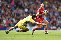 Wales's William Harries evades the tackle of Australia's Pama Fou<br /> <br /> Australia Vs Wales - Men's quarter-final<br /> <br /> Photographer Chris Vaughan/CameraSport<br /> <br /> 20th Commonwealth Games - Day 4 - Sunday 27th July 2014 - Rugby Sevens - Ibrox Stadium - Glasgow - UK<br /> <br /> © CameraSport - 43 Linden Ave. Countesthorpe. Leicester. England. LE8 5PG - Tel: +44 (0) 116 277 4147 - admin@camerasport.com - www.camerasport.com