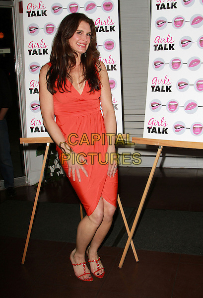 """BROOKE SHIELDS.Opening Night of Brooke Shields Starring in """"Girls Talk"""" held at The Lee Strasberg Theater, West Hollywood, California, USA, 18th March 2011..full length  orange dress  red sandals gold cuff .CAP/ADM/FS.©Faye Sadou/AdMedia/Capital Pictures."""