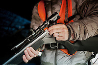 OutdoorLife Editor Andrew McKean (cq) loads his rifle during a hunt for white tail deer in Superior, Nebraska, Thursday, December 1, 2011. ..Photo by Matt Nager