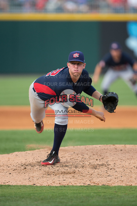 US Collegiate National Team starting pitcher Robert Tyler (22) follows through on his delivery against the Cuban National Team at BB&T BallPark on July 4, 2015 in Charlotte, North Carolina.  The United State Collegiate National Team defeated the Cuban National Team 11-1.  (Brian Westerholt/Four Seam Images)