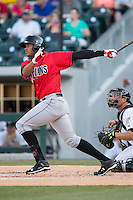 Willy Garcia (18) of the Indianapolis Indians follows through on his swing against the Charlotte Knights at BB&T BallPark on June 20, 2015 in Charlotte, North Carolina.  The Knights defeated the Indians 6-5 in 12 innings.  (Brian Westerholt/Four Seam Images)