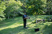 United States President Barack Obama makes a statement on Iraq during his vacation in Chilmark, Martha's Vineyard, MA on August 11, 2014.  In his remarks, the President announced he had called new Iraqi Prime Minister Haider Al-Abadi to offer his support and congratulations. <br /> Credit: Rick Friedman / Pool via CNP