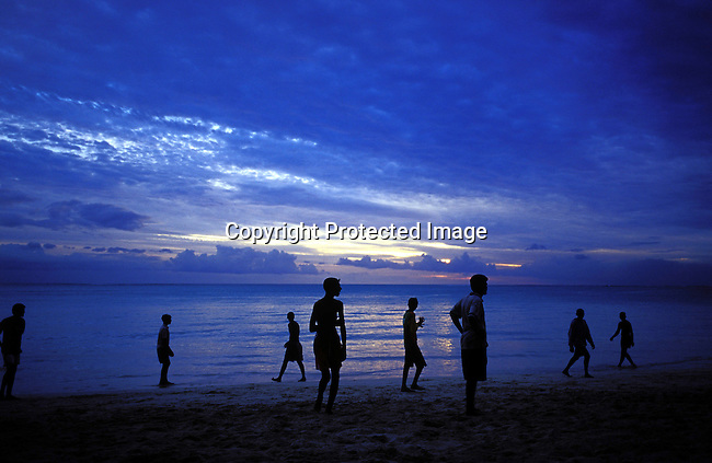 dicomau00021.Foreign Country. Mauritius.Youths playing soccer on the beach as the suns sets on July 4, 2003, on Mauritius. The island, located in the Indian Ocean, is a popular place for tourists. .©Per-Anders Pettersson/iAfrika Photos