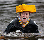 Ken Kietter , of Rosedale, Washington, gets out of the water after participating in the 23rd annual Olalla polar bear jump into the Burley lagoon in Olalla, Washington on January 1, 2007. This is his eight time jumping off the bridge on New Years Day. Jim Bryant Photo. ©2010. ALL RIGHTS RESERVED.