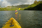 Woman kayaking the Wailua River, Kauai, Hawaii